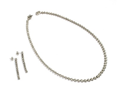 Lot 81 - A silver diamond set necklace and earrings suite