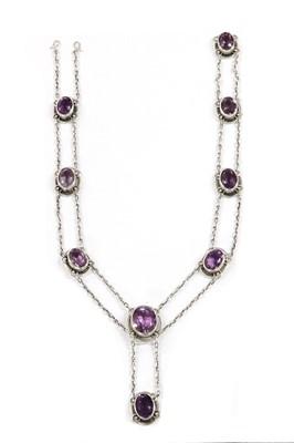Lot 1051 - An Art Nouveau silver amethyst necklace, by Murrle Bennett & Co., c.1910