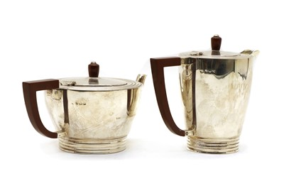 Lot 11 - A silver teapot and a hot water jug