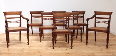 Lot 489 - A matched set of eight Anglo-Indian Regency-style teak dining chairs