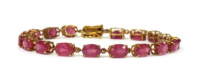 Lot 90 - A 9ct gold fracture filled ruby set bracelet