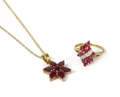 Lot 96 - A 9ct gold fracture filled ruby set star cluster pendant
