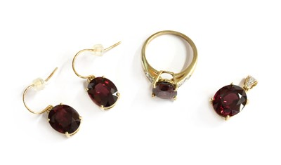 Lot 98 - A 9ct gold garnet and diamond ring, pendant and earrings suite