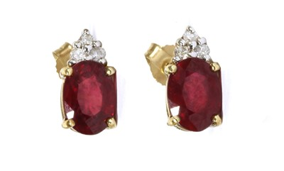Lot 92 - A pair of 9ct gold fracture filled ruby and diamond earrings