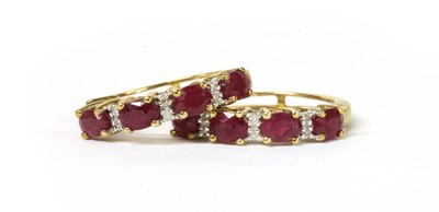 Lot 93 - A pair of 9ct gold fracture filled ruby and diamond hoop earrings