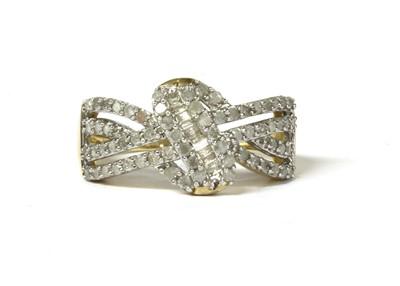 Lot 29 - A 9ct gold diamond set knot design ring