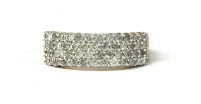 Lot 27 - A 9ct gold four row diamond ring