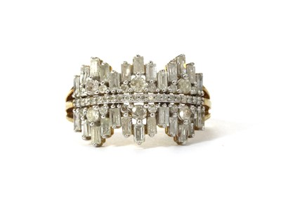Lot 31 - A 9ct gold baguette and brilliant cut diamond ring
