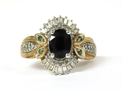 Lot 103 - A 9ct gold sapphire and diamond cluster ring