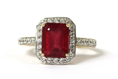 Lot 94 - A 9ct gold fracture filled ruby and zircon halo cluster ring