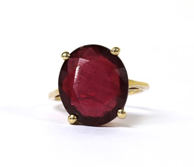 Lot 89 - A 9ct gold single stone fracture filled ruby ring
