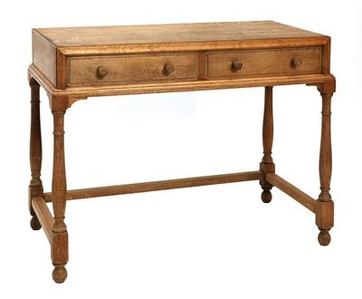 Lot 83 - A Cotswold School oak dressing table