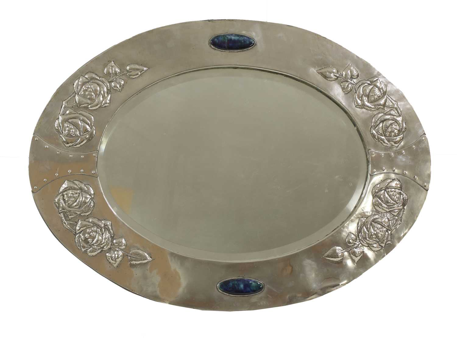 Lot 82 - An Arts and Crafts silver-plated oval wall mirror