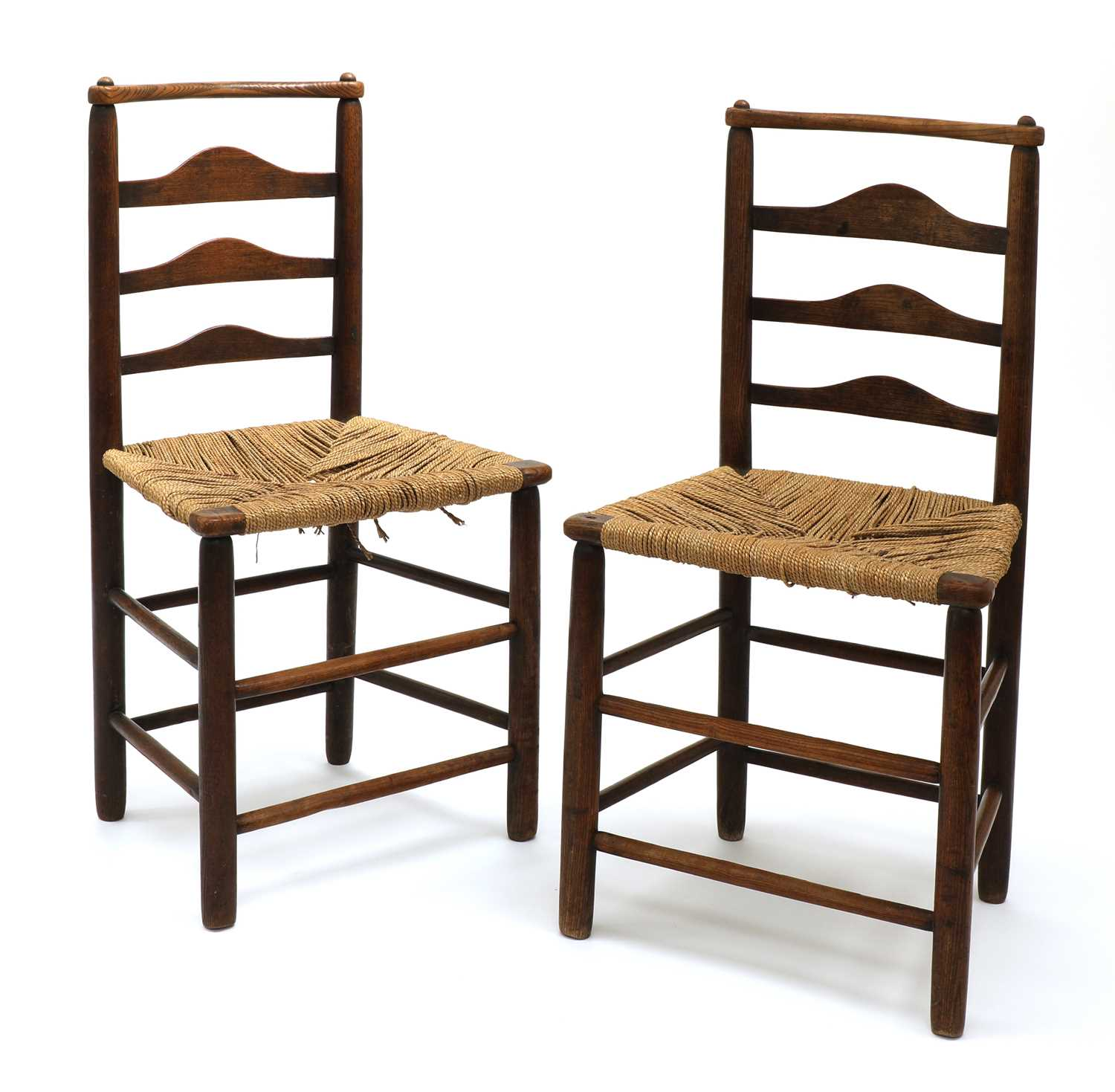 Lot 80 - A pair of Arts and Crafts oak chairs