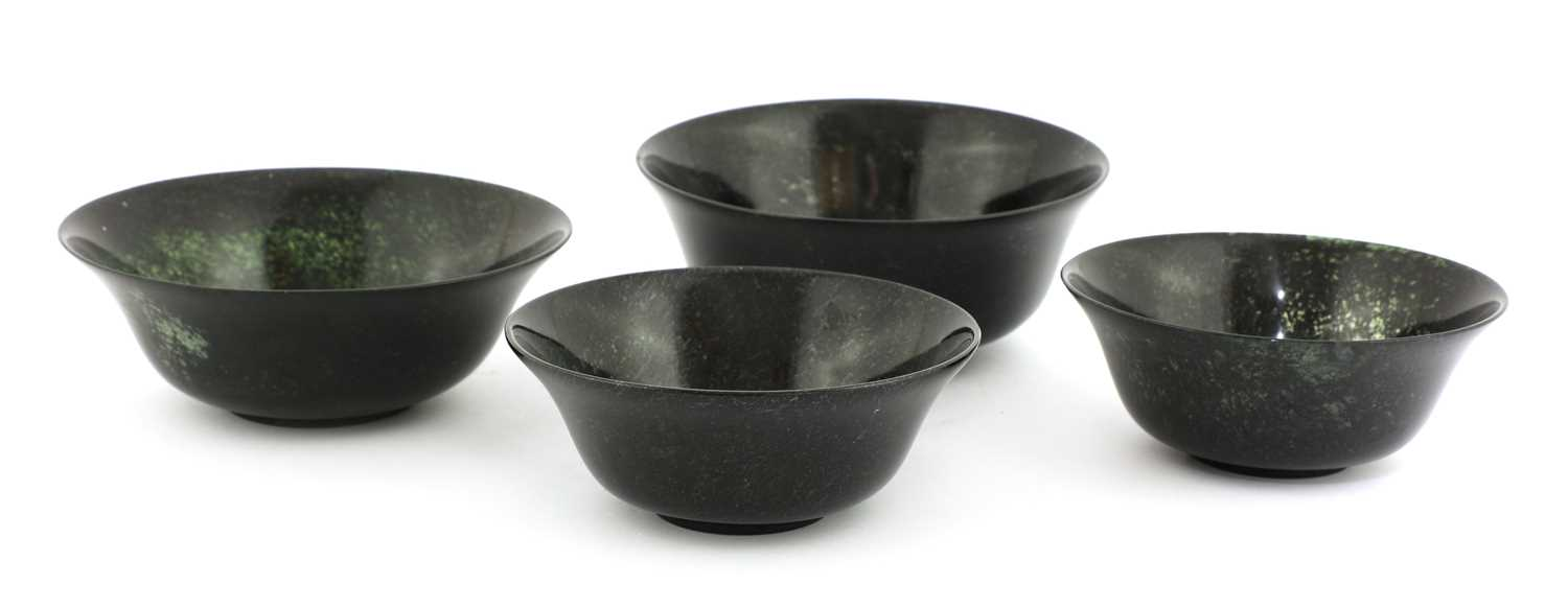 Lot 83 - Four Chinese spinach jade bowls