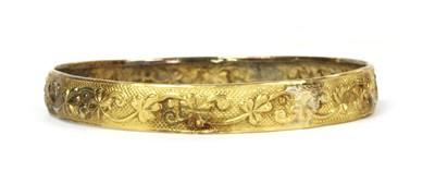 Lot 86 - A gold bangle