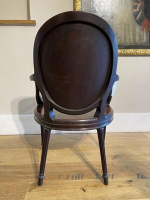 Lot 12 - A pair of mahogany hall chairs