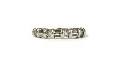 Lot 47 - A white gold diamond half eternity ring