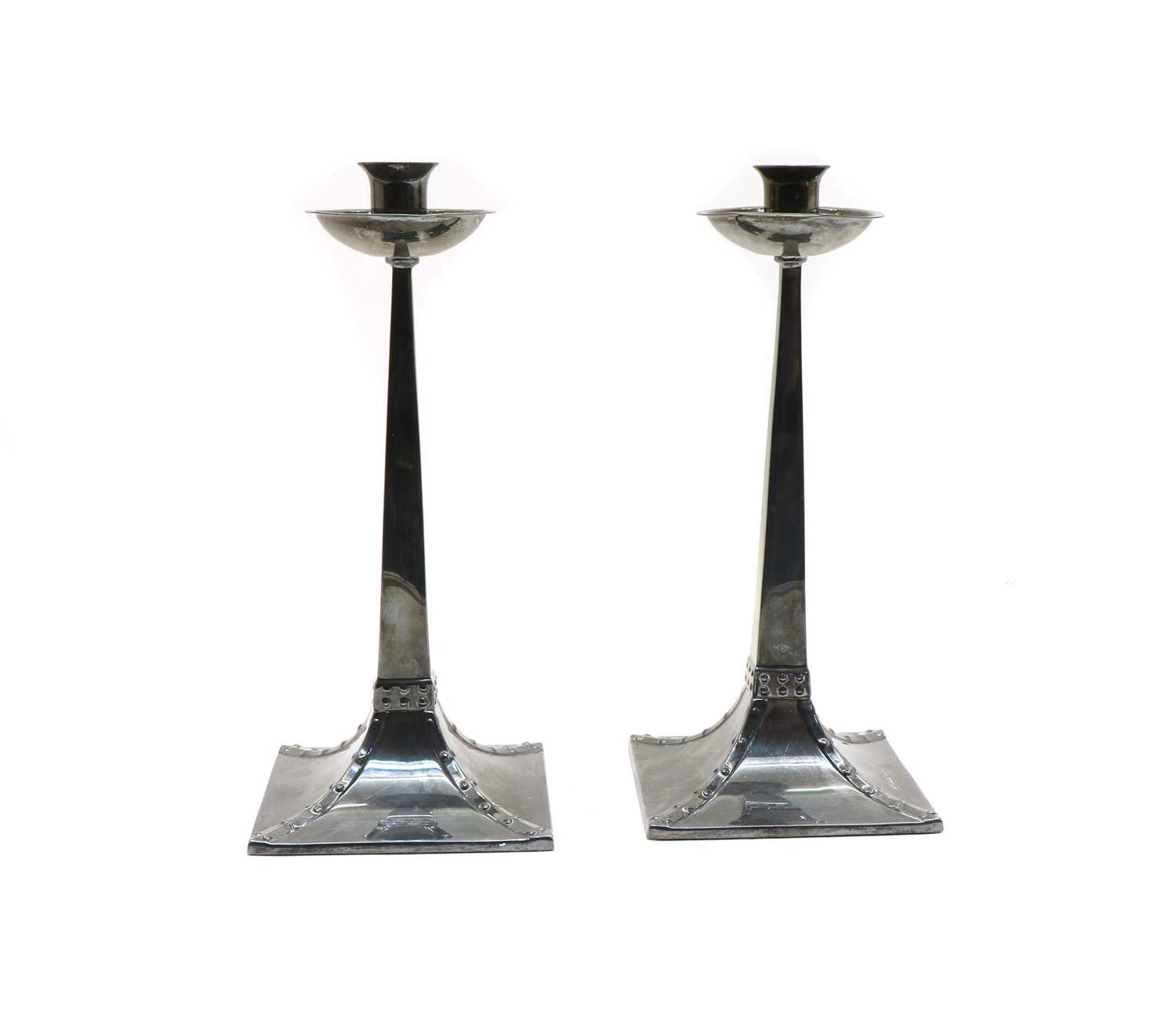 Lot 78 - A pair of Arts and Crafts-style silver candlesticks