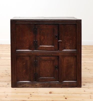 Lot 402 - An oak cupboard