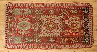 Lot 490 - A kilim flatweave rug