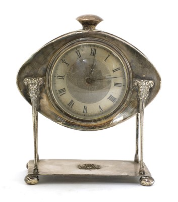 Lot 72 - An Arts and Crafts silver-plated desk clock