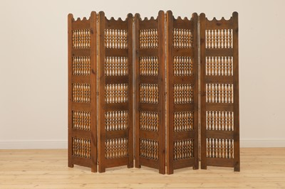 Lot 478 - A Spanish fruitwood folding screen
