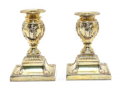 Lot 52 - A pair of silver-gilt dwarf candlesticks