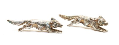 Lot 64 - Two silver running fox ornaments