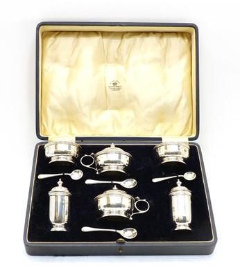 Lot 60 - A cased silver cruet set