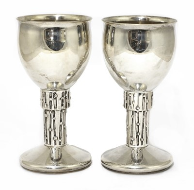 Lot 606 - A pair of silver goblets