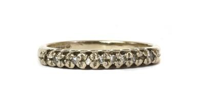 Lot 45 - An 18ct white gold diamond half eternity ring