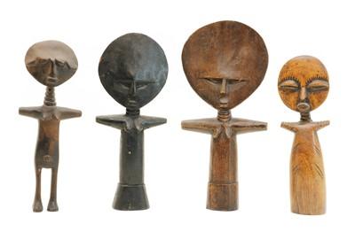 Lot 82 - Four Ashanti carved wooden disc head fertility dolls