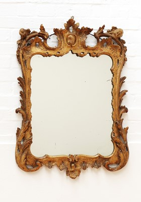 Lot 66 - A George III carved giltwood mirror