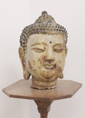 Lot 493 - A cast and painted metal head of Buddha