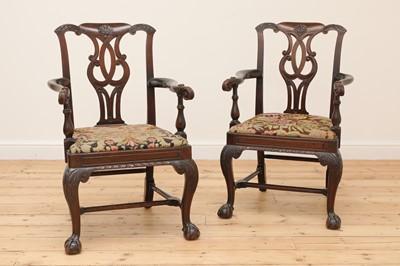Lot 396 - A pair of Irish mahogany open armchairs