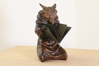 Lot 394 - A Swiss Black Forest carved lindenwood figure of a fox
