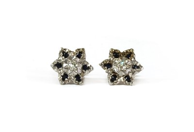 Lot 107 - A pair of 9ct gold diamond and sapphire cluster earrings