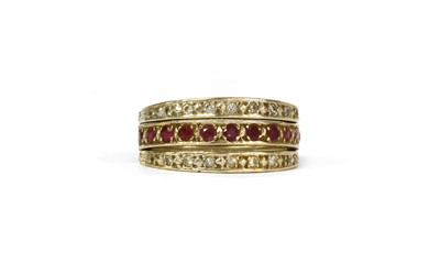 Lot 102 - A 9ct gold ruby and sapphire 'night and day' eternity ring