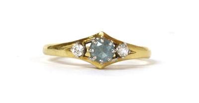 Lot 105 - An 18ct gold three stone aquamarine and diamond ring