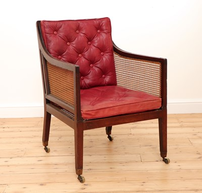 Lot 498 - A Regency-style mahogany caned bergère