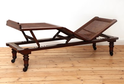 Lot 470 - A Victorian caned campaign daybed