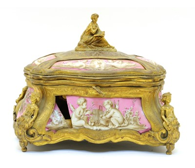 Lot 92 - A French porcelain and ormolu jewellery casket