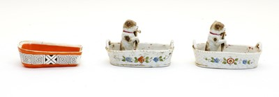Lot 79 - A pair of pottery ornaments
