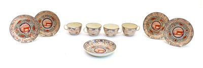 Lot 97 - Four silver lustre pottery teacups and five saucers