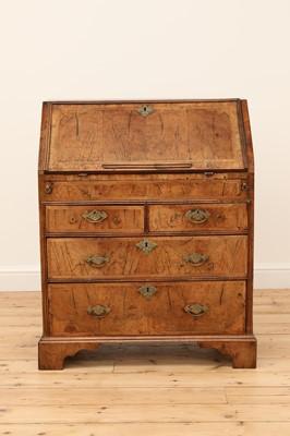 Lot 452 - A George II feather strung and crossbanded walnut bureau