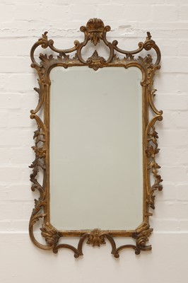 Lot 71 - A George III-style carved giltwood wall mirror