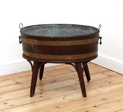 Lot 72 - A George III brass-bound mahogany oval wine cooler