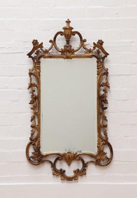 Lot 35 - A George III-style giltwood wall mirror
