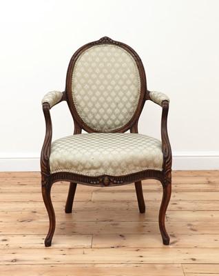 Lot 62 - A carved beech open armchair